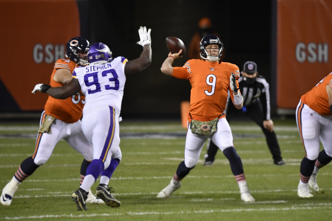 Nov 16, 2020; Chicago, Illinois, USA; Chicago Bears quarterback Nick Foles (9) throws the football in the first quarter against the pressure from Minnesota Vikings defensive tackle Shamar Stephen (93) at Soldier Field. Mandatory Credit: Quinn Harris-USA TODAY Sports