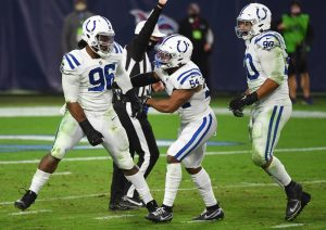 Nov 12, 2020; Nashville, Tennessee, USA; Indianapolis Colts defensive tackle Denico Autry (96) celebrates a sack with Indianapolis Colts middle linebacker Anthony Walker (54) and Indianapolis Colts defensive tackle Grover Stewart (90) during the second half against the Tennessee Titans at Nissan Stadium. Mandatory Credit: Christopher Hanewinckel-USA TODAY Sports