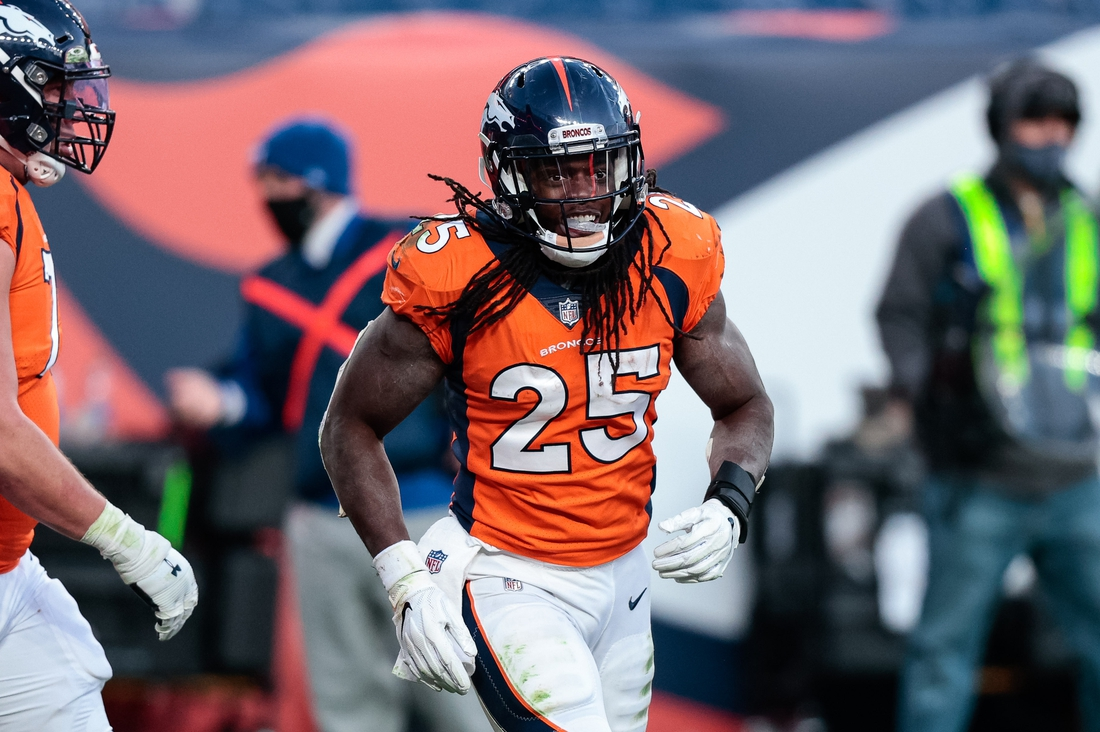 Nov 22, 2020; Denver, Colorado, USA; Denver Broncos running back Melvin Gordon III (25) after his touchdown in the third quarter against the Miami Dolphins at Empower Field at Mile High. Mandatory Credit: Isaiah J. Downing-USA TODAY Sports