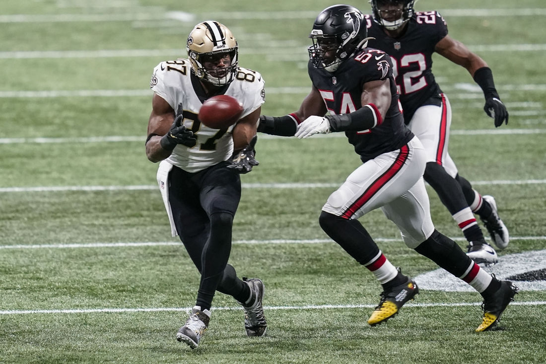 Dec 6, 2020; Atlanta, Georgia, USA; New Orleans Saints tight end Jared Cook (87) catches a pass in front of Atlanta Falcons linebacker Foyesade Oluokun (54) during the first quarter at Mercedes-Benz Stadium. Mandatory Credit: Dale Zanine-USA TODAY Sports
