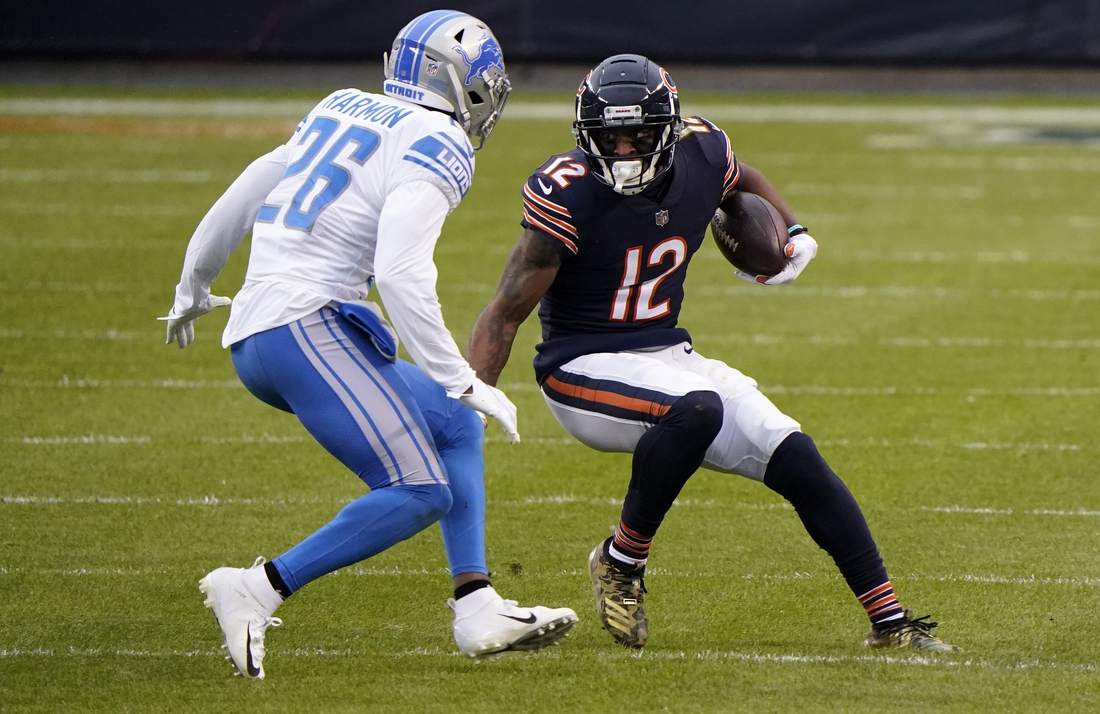 Dec 6, 2020; Chicago, Illinois, USA; Chicago Bears wide receiver Allen Robinson (12) makes a catch against Detroit Lions strong safety Duron Harmon (26) during the second quarter at Soldier Field. Mandatory Credit: Mike Dinovo-USA TODAY Sports