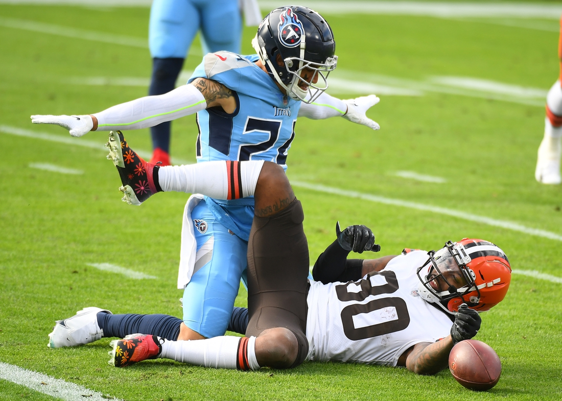 Dec 6, 2020; Nashville, Tennessee, USA; Tennessee Titans strong safety Kenny Vaccaro (24) breaks up a pass intended for Cleveland Browns wide receiver Jarvis Landry (80) at Nissan Stadium. Mandatory Credit: Christopher Hanewinckel-USA TODAY Sports