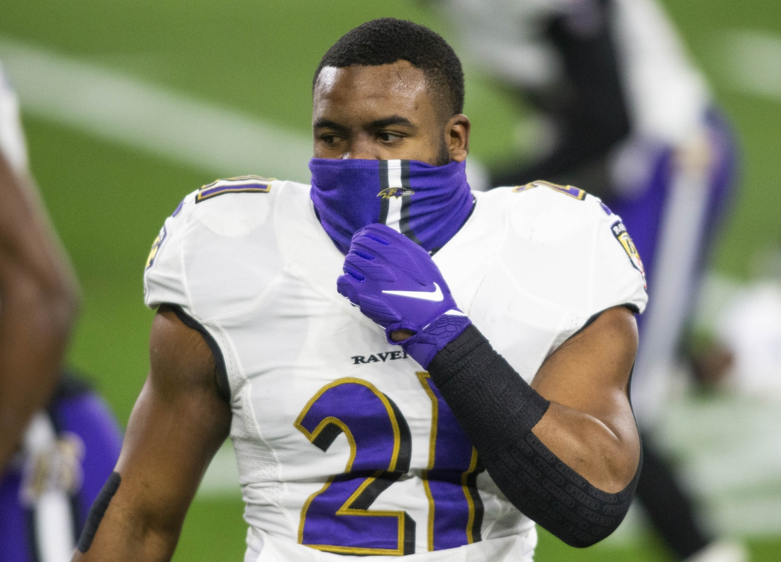 Dec 14, 2020; Cleveland, Ohio, USA; Baltimore Ravens running back Mark Ingram (21) adjusts his face mask before the game against the Cleveland Browns at FirstEnergy Stadium. Mandatory Credit: Scott Galvin-USA TODAY Sports