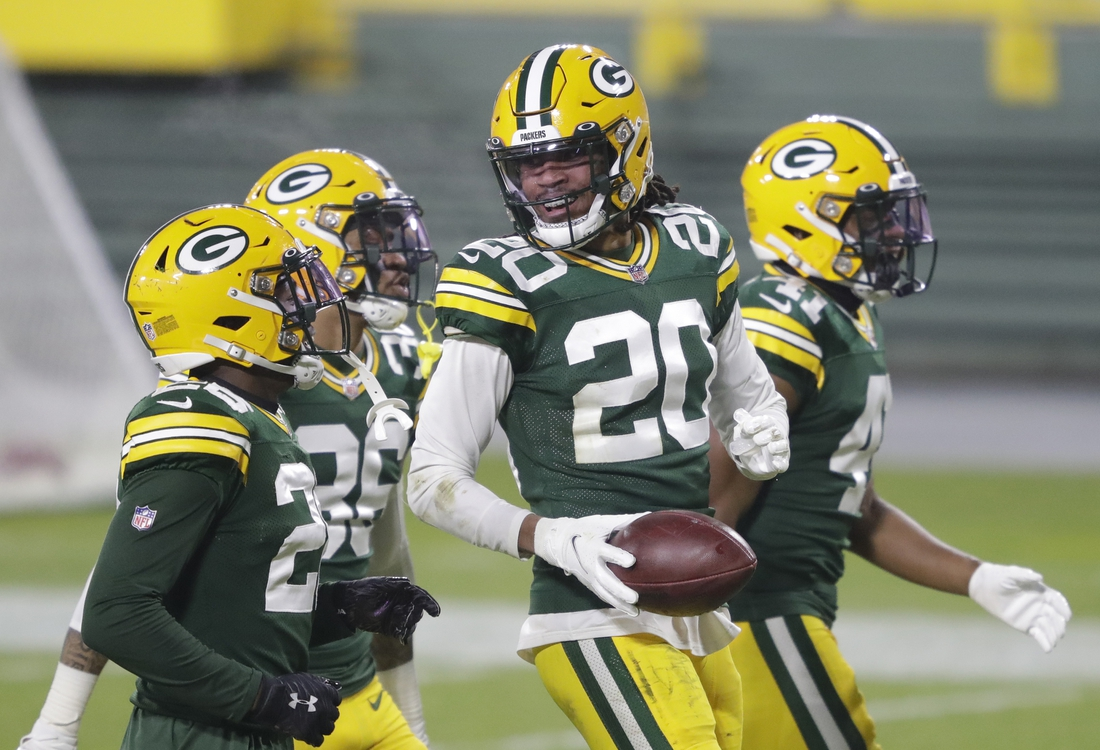 Dec 19, 2020; Green Bay, WI, USA;  Green Bay Packers cornerback Kevin King (20) celebrates a fumble recovery against the Carolina Panthers during their football game Saturday, December 19, 2020, at Lambeau Field in Green Bay, Wis.  Mandatory Credit: Dan Powers-USA TODAY NETWORK