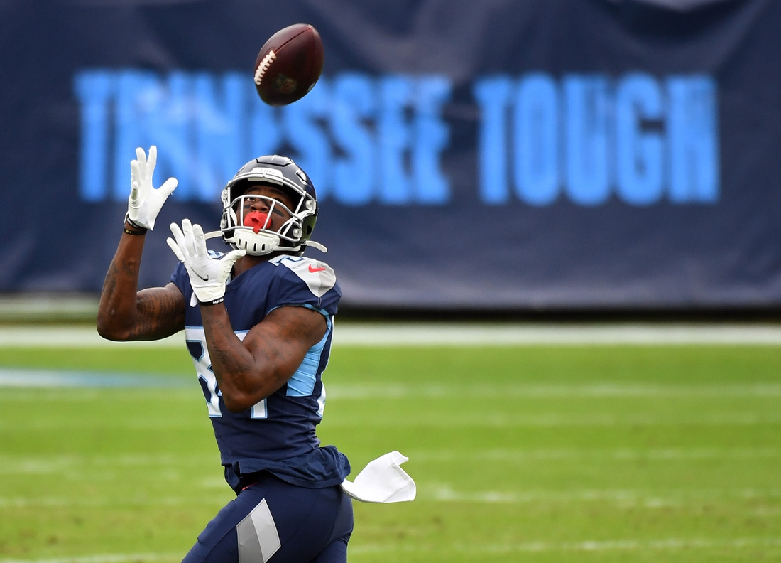 Dec 20, 2020; Nashville, Tennessee, USA; Tennessee Titans wide receiver Corey Davis (84) catches a 75-yard touchdown pass against the Detroit Lions during the first half at Nissan Stadium. Mandatory Credit: Christopher Hanewinckel-USA TODAY Sports