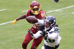 Dec 20, 2020; Landover, Maryland, USA; Seattle Seahawks cornerback Shaquill Griffin (26) intercepts a pass in front of Washington Football Team wide receiver Cam Sims (89) in the second quarter at FedExField. Mandatory Credit: Geoff Burke-USA TODAY Sports