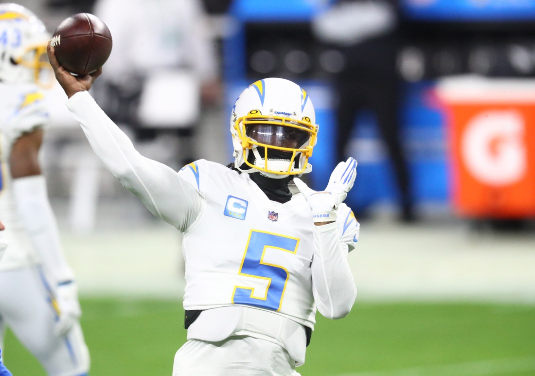 Dec 17, 2020; Paradise, Nevada, USA; Los Angeles Chargers quarterback Tyrod Taylor (5) against the Las Vegas Raiders at Allegiant Stadium. Mandatory Credit: Mark J. Rebilas-USA TODAY Sports