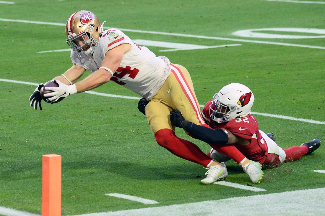 Dec 26, 2020; Glendale, Arizona, USA; San Francisco 49ers fullback Kyle Juszczyk (44) dives for a touchdown against Arizona Cardinals strong safety Budda Baker (32) during the second half at State Farm Stadium. Mandatory Credit: Joe Camporeale-USA TODAY Sports