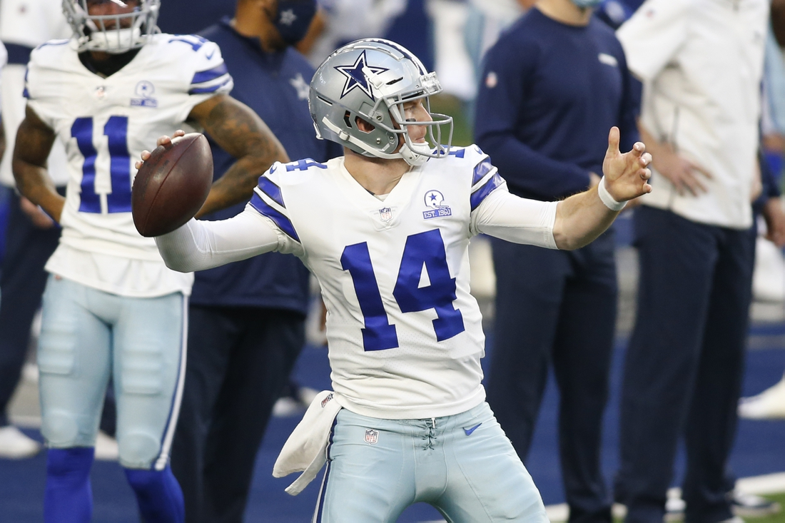 Dec 27, 2020; Arlington, Texas, USA; Dallas Cowboys quarterback Andy Dalton (14) throws a pass before the game against the Philadelphia Eagles at AT&T Stadium. Mandatory Credit: Tim Heitman-USA TODAY Sports