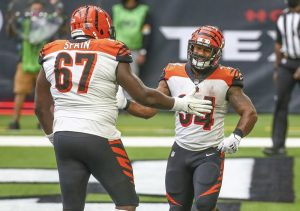 Dec 27, 2020; Houston, Texas, USA; Cincinnati Bengals running back Samaje Perine (34) celebrates with offensive guard Quinton Spain (67) after scoring a touchdown against the Houston Texans during the fourth quarter at NRG Stadium. Mandatory Credit: Troy Taormina-USA TODAY Sports