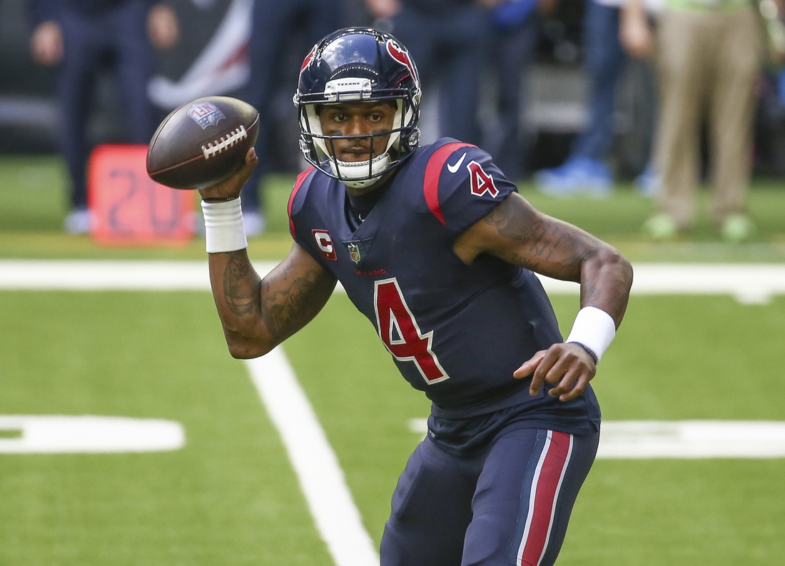 Dec 27, 2020; Houston, Texas, USA; Houston Texans quarterback Deshaun Watson (4) rolls out of the pocket against the Cincinnati Bengals during the third quarter at NRG Stadium. Mandatory Credit: Troy Taormina-USA TODAY Sports