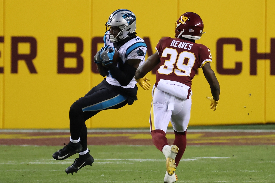 Dec 27, 2020; Landover, Maryland, USA; Carolina Panthers wide receiver Curtis Samuel (10) catches a pass as Washington Football Team defensive back Jeremy Reaves (39) in the second quarter at FedExField. Mandatory Credit: Geoff Burke-USA TODAY Sports