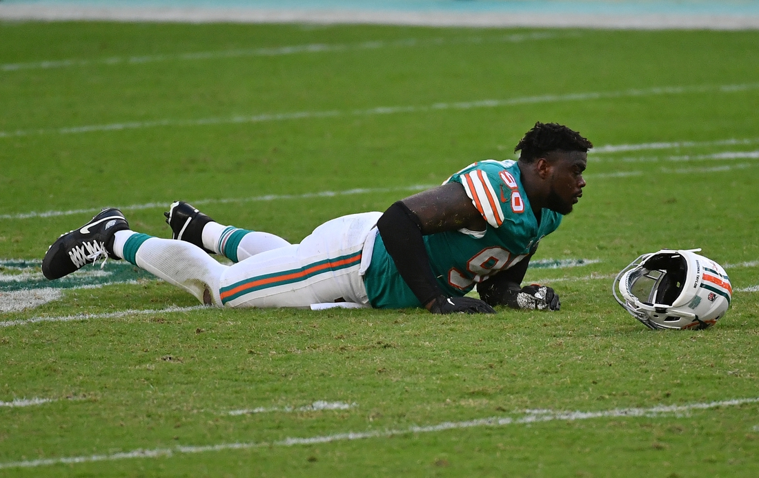Dec 20, 2020; Miami Gardens, Florida, USA; Miami Dolphins outside linebacker Shaq Lawson (90) lies on the ground after a play against the New England Patriots during the second half at Hard Rock Stadium. Mandatory Credit: Jasen Vinlove-USA TODAY Sports