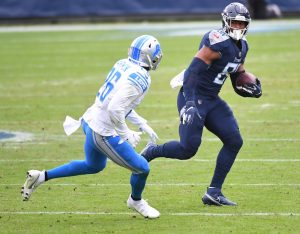 Dec 20, 2020; Nashville, Tennessee, USA; Tennessee Titans tight end Jonnu Smith (81) runs after a catch before being hit by Detroit Lions strong safety Duron Harmon (26) during the first half at Nissan Stadium. Mandatory Credit: Christopher Hanewinckel-USA TODAY Sports