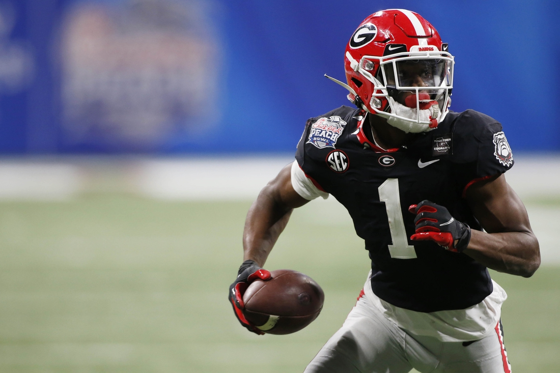 Jan 1, 2021; Atlanta, GA, USA; Georgia wide receiver George Pickens (1) moves the ball after pulling in a pass from Georgia quarterback JT Daniels (18) during the second half of the Peach Bowl NCAA college football game between Georgia and Cincinnati at Mercedes-Benz Stadium in Atlanta., on Friday, Jan. 1, 2021.  Georgia won 24-21. Mandatory Credit: Joshua L. Jones-USA TODAY NETWORK