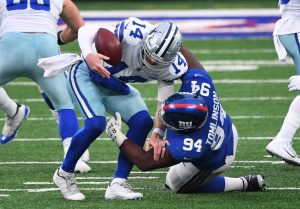 Jan 3, 2021; East Rutherford, NJ, USA; Dallas Cowboys quarterback Andy Dalton (14) is sacked by New York Giants nose tackle Dalvin Tomlinson (94) in the first half at MetLife Stadium. Mandatory Credit: Robert Deutsch-USA TODAY Sports