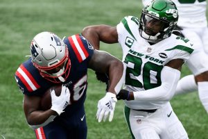 Jan 3, 2021; Foxborough, Massachusetts, USA; New England Patriots running back Sony Michel (26) rushes against New York Jets free safety Marcus Maye (20) during the first quarter at Gillette Stadium. Mandatory Credit: Brian Fluharty-USA TODAY Sports