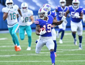 Jan 3, 2021; Orchard Park, New York, USA; Buffalo Bills wide receiver Isaiah McKenzie (19) returns a punt for a touchdown against the Miami Dolphins in the second quarter at Bills Stadium. Mandatory Credit: Mark Konezny-USA TODAY Sports