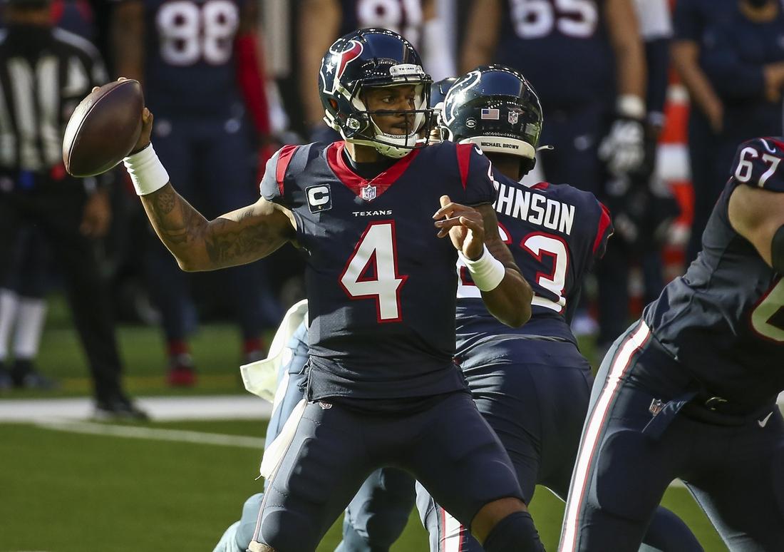 Jan 3, 2021; Houston, Texas, USA; Houston Texans quarterback Deshaun Watson (4) throws a pass against the Tennessee Titans during the first quarter at NRG Stadium. Mandatory Credit: Troy Taormina-USA TODAY Sports