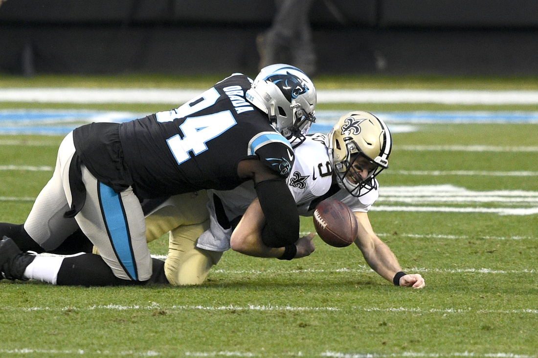 Jan 3, 2021; Charlotte, North Carolina, USA; Carolina Panthers defensive end Efe Obada (94) forces a fumble by New Orleans Saints quarterback Drew Brees (9) in the first quarter at Bank of America Stadium. Mandatory Credit: Bob Donnan-USA TODAY Sports