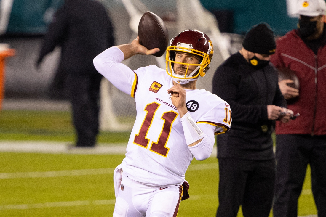 Jan 3, 2021; Philadelphia, Pennsylvania, USA; Washington Football Team quarterback Alex Smith (11) warms up before a game against the Philadelphia Eagles at Lincoln Financial Field. Mandatory Credit: Bill Streicher-USA TODAY Sports