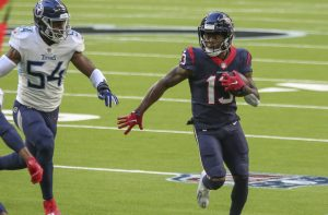 Jan 3, 2021; Houston, Texas, USA; Houston Texans wide receiver Brandin Cooks (13) runs with the ball during the second quarter as Tennessee Titans inside linebacker Rashaan Evans (54) defends at NRG Stadium. Mandatory Credit: Troy Taormina-USA TODAY Sports