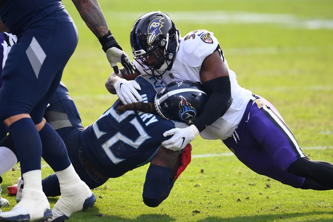 Jan 10, 2021; Nashville, Tennessee, USA; Tennessee Titans running back Derrick Henry (22) is tackled by Baltimore Ravens linebacker Tyus Bowser (54) during the third quarter in a AFC Wild Card playoff game at Nissan Stadium. Mandatory Credit: Christopher Hanewinckel-USA TODAY Sports