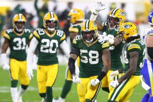 Jan 16, 2021; Green Bay, Wisconsin, USA; Green Bay Packers linebacker Christian Kirksey (58) celebrates with his team during the first half of a NFC Divisional Round playoff game against the Los Angeles Rams at Lambeau Field. Mandatory Credit: Mark J. Rebilas-USA TODAY Sports