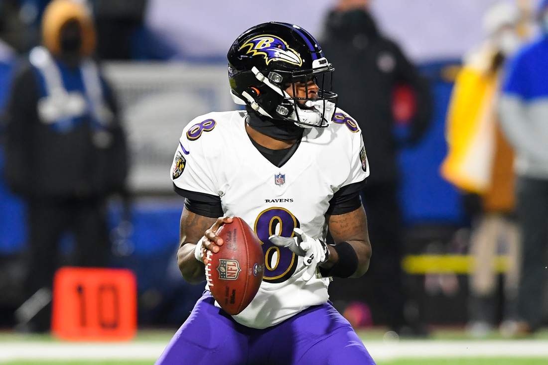 Jan 16, 2021; Orchard Park, New York, USA; Baltimore Ravens quarterback Lamar Jackson (8) drops back to pass against the Buffalo Bills during the first quarter of an AFC Divisional Round game at Bills Stadium. Mandatory Credit: Rich Barnes-USA TODAY Sports