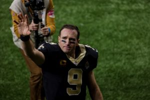 Jan 17, 2021; New Orleans, Louisiana, USA; New Orleans Saints quarterback Drew Brees (9) blows a kiss to his family as he walks to the tunnel following a 30-20 loss against the Tampa Bay Buccaneers in a NFC Divisional Round playoff game at the Mercedes-Benz Superdome. Mandatory Credit: Derick E. Hingle-USA TODAY Sports