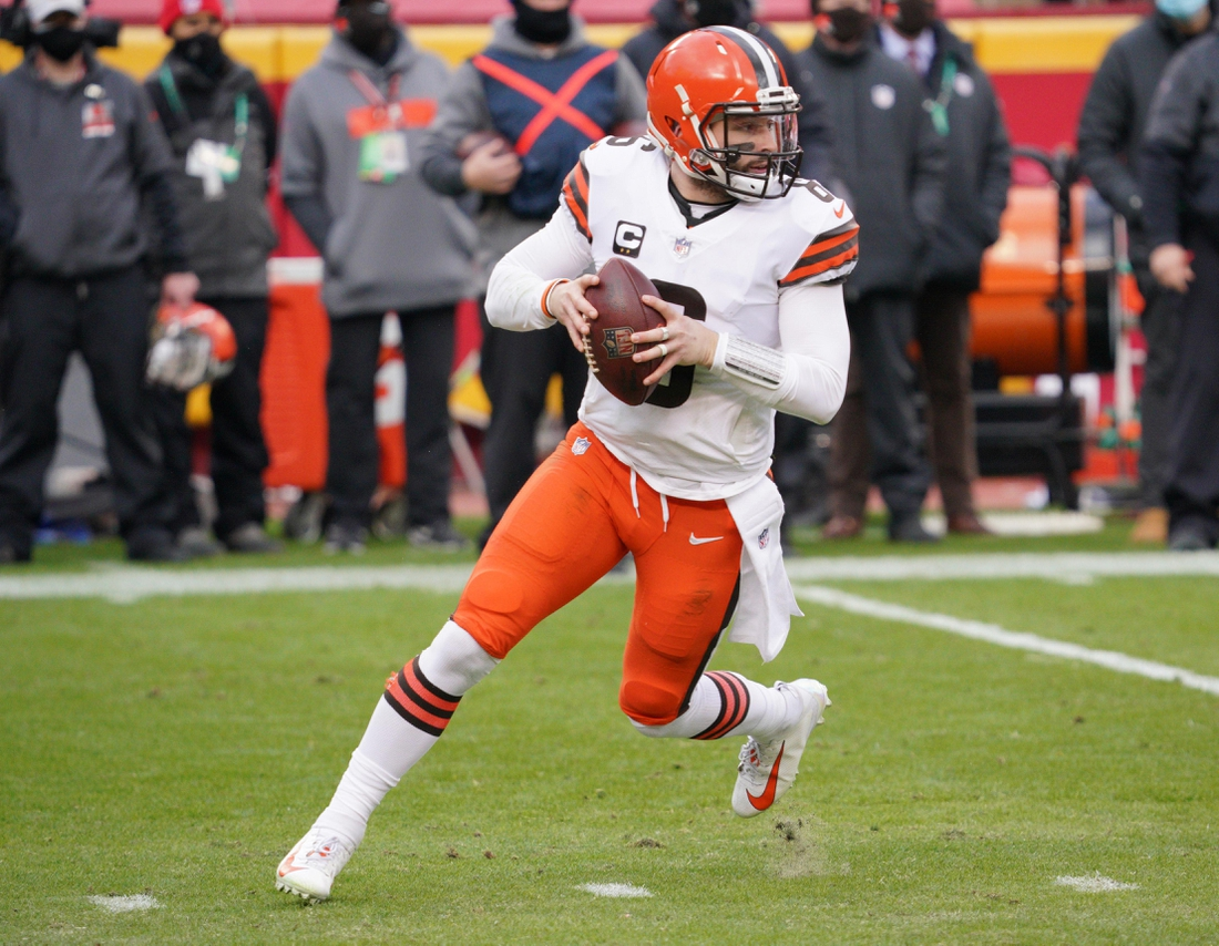 Jan 17, 2021; Kansas City, Missouri, USA; Cleveland Browns quarterback Baker Mayfield (6) drops back to pass during the AFC Divisional Round playoff game against the Kansas City Chiefs at Arrowhead Stadium. Mandatory Credit: Denny Medley-USA TODAY Sports