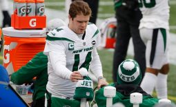 Jan 3, 2021; Foxborough, Massachusetts, USA; New York Jets quarterback Sam Darnold (14) on the bench against the New England Patriots during the first half at Gillette Stadium. Mandatory Credit: Winslow Townson-USA TODAY Sports
