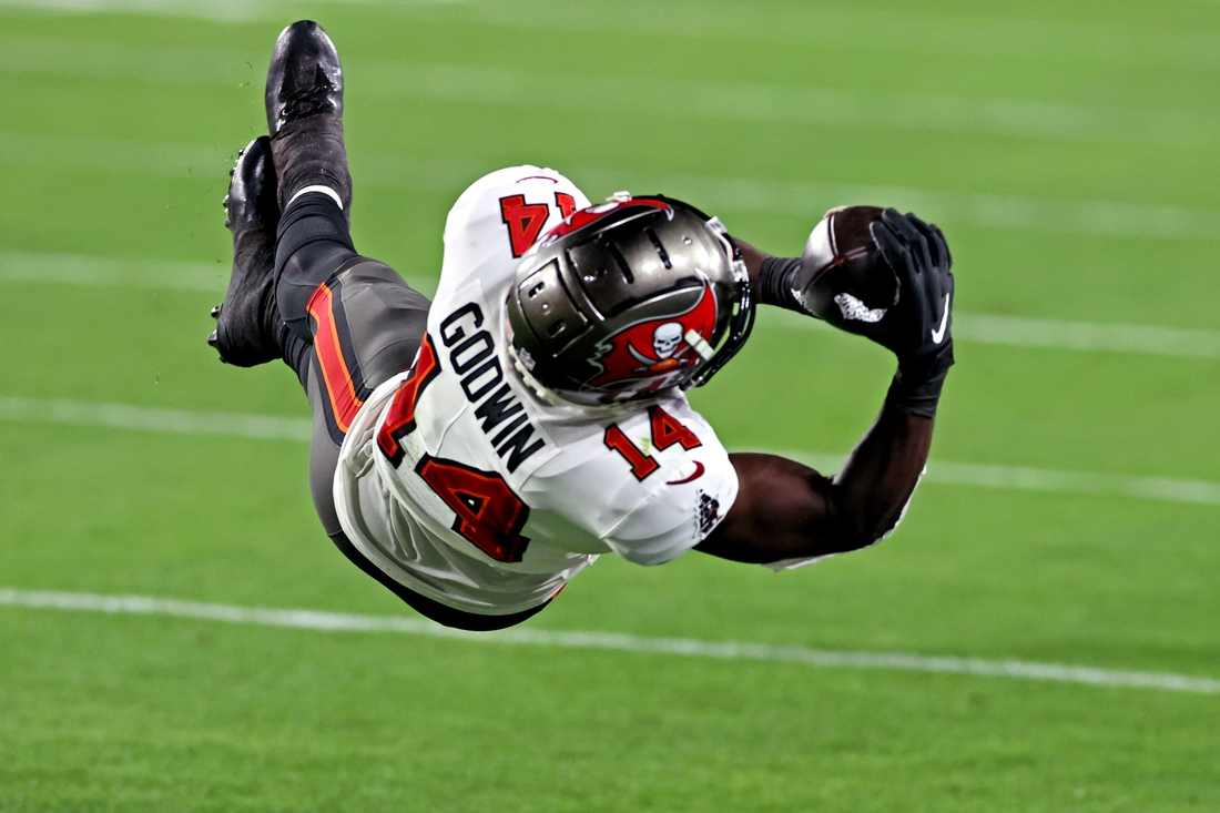 Feb 7, 2021; Tampa, FL, USA;  Tampa Bay Buccaneers wide receiver Chris Godwin (14) makes a catch during the third quarter against the Kansas City Chiefs in Super Bowl LV at Raymond James Stadium.  Mandatory Credit: Matthew Emmons-USA TODAY Sports