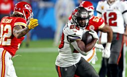 Feb 7, 2021; Tampa, FL, USA;  Tampa Bay Buccaneers running back Leonard Fournette (28) runs the ball against Kansas City Chiefs strong safety Tyrann Mathieu (32) during the fourth quarter in Super Bowl LV at Raymond James Stadium.  Mandatory Credit: Matthew Emmons-USA TODAY Sports