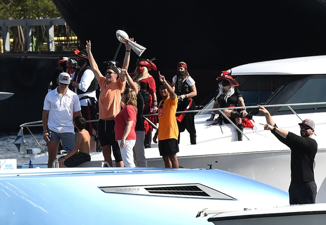 Feb 10, 2021; Tampa Bay, Florida, USA;   Tampa Bay Buccaneers quarterback Tom Brady celebrates with the Vince Lombardi Trophy on his boat during the  Tampa Bay Buccaneers boat parade to celebrate their victory over the Kansas City Chiefs in Super Bowl LV. Mandatory Credit: Jonathan Dyer-USA TODAY Sports