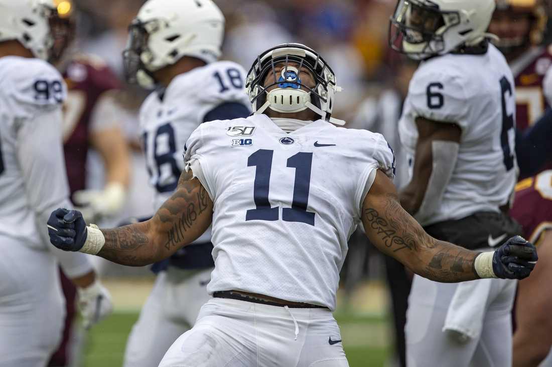 Nov 9, 2019; Minneapolis, MN, USA; Penn State Nittany Lions linebacker Micah Parsons (11) celebrates after sacking the Minnesota Golden Gophers quarterback Tanner Morgan (not pictured) in the second half at TCF Bank Stadium. Mandatory Credit: Jesse Johnson-USA TODAY Sports