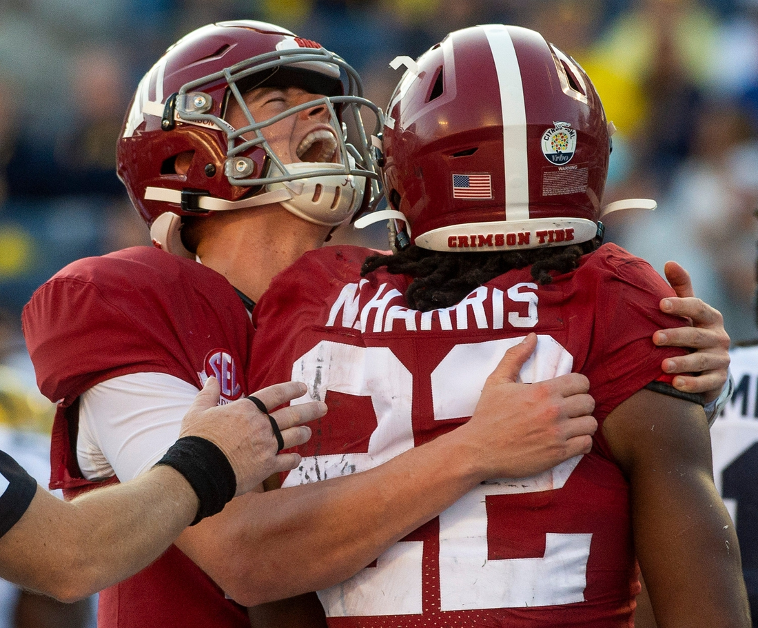 Alabama quarterback Mac Jones (10) his Alabama running back Najee Harris (22) after Harris' late touchdown against Michigan in the Citrus Bowl in Orlando, Fla., on Wednesday January 1, 2020.  Cit24