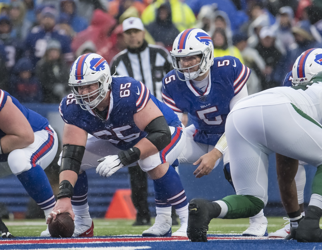 Dec 29, 2019; Orchard Park, New York, USA; Buffalo Bills offensive guard Ike Boettger (65) prepares to snap the ball to quarterback Matt Barkley (5) in the second quarter against the New York Jets at New Era Field. Mandatory Credit: Mark Konezny-USA TODAY Sports
