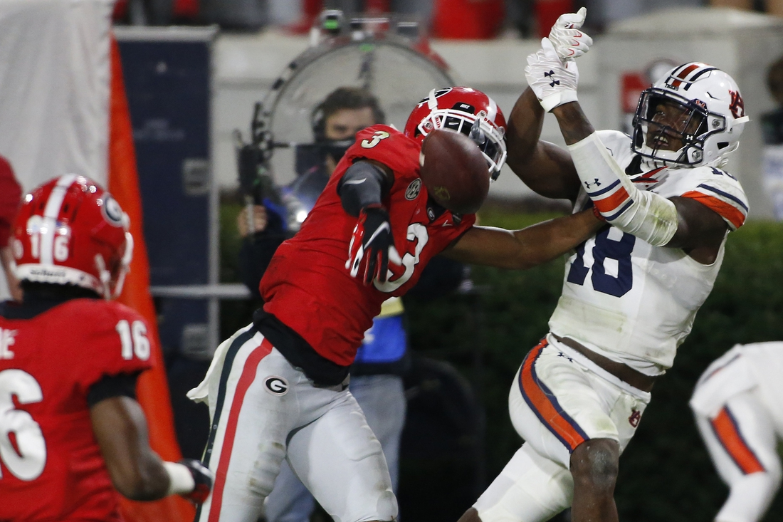 Oct 3, 2020; Athens, GA, USA; Georgia defensive back Tyson Campbell (3) breaks up a pass from Auburn quarterback Bo Nix (10) to Auburn wide receiver Seth Williams (18) during the second half of an NCAA college football game between Georgia and Auburn in Athens, Ga., on Saturday, Oct. 3, 2020. Georgia won 27-6.  Mandatory Credit: Joshua L. Jones-USA TODAY NETWORK