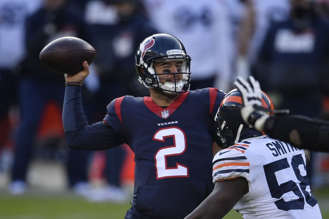 Dec 13, 2020; Chicago, Illinois, USA; Houston Texans quarterback AJ McCarron (2) passes in the second half against Chicago Bears inside linebacker Roquan Smith (58) at Soldier Field. Mandatory Credit: Quinn Harris-USA TODAY Sports