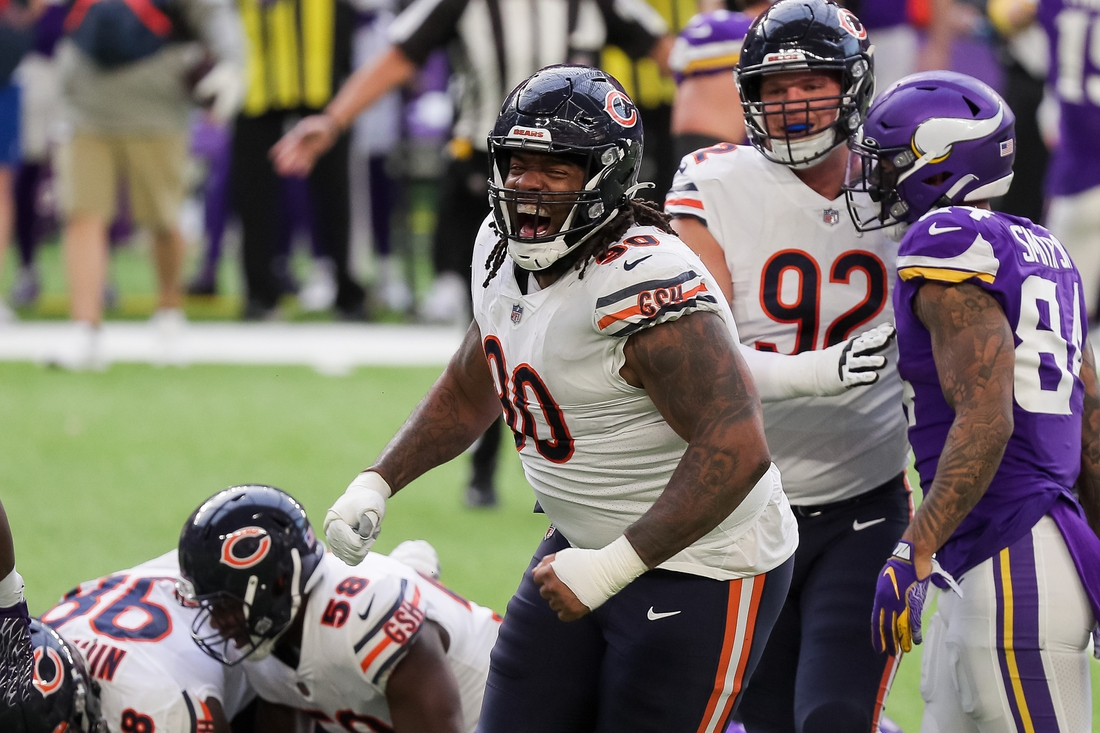 Dec 20, 2020; Minneapolis, Minnesota, USA; Chicago Bears defensive lineman John Jenkins (90) celebrates a tackle in the second quarter against the Minnesota Vikings at U.S. Bank Stadium. Mandatory Credit: Brad Rempel-USA TODAY Sports