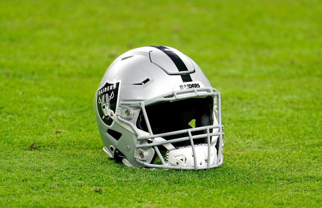 Dec 26, 2020; Paradise, Nevada, USA; A Las Vegas Raiders helmet rest on the football field before a game against the Miami Dolphins at Allegiant Stadium. Mandatory Credit: Kirby Lee-USA TODAY Sports