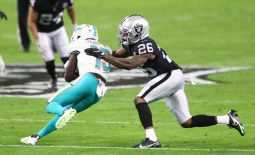 Dec 26, 2020; Paradise, Nevada, USA; Miami Dolphins wide receiver Jakeem Grant (19) is tackled by Las Vegas Raiders cornerback Nevin Lawson (26) at Allegiant Stadium. Mandatory Credit: Mark J. Rebilas-USA TODAY Sports