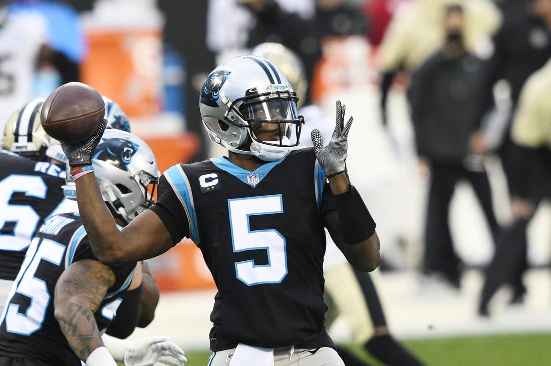 Jan 3, 2021; Charlotte, North Carolina, USA; Carolina Panthers quarterback Teddy Bridgewater (5) looks to pass in the first quarter at Bank of America Stadium. Mandatory Credit: Bob Donnan-USA TODAY Sports