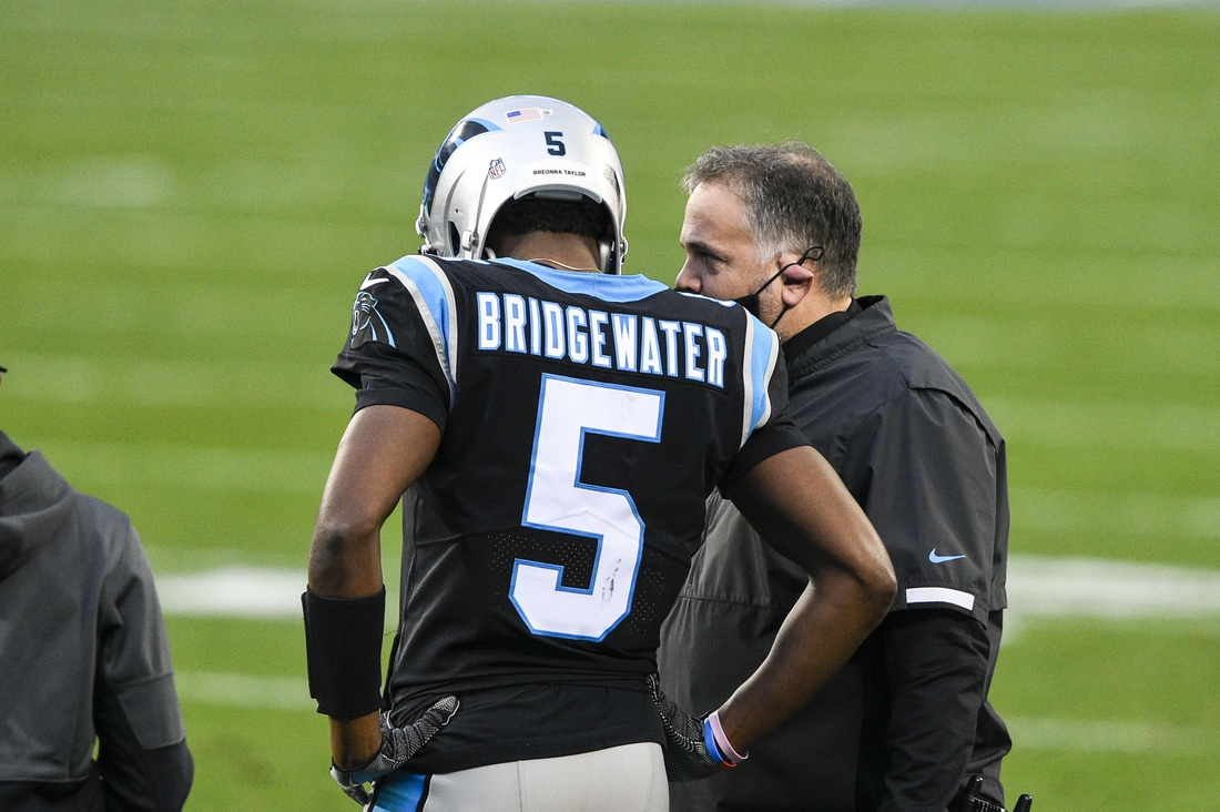 Jan 3, 2021; Charlotte, North Carolina, USA; Carolina Panthers head coach Matt Rhule with quarterback Teddy Bridgewater (5) in the first quarter at Bank of America Stadium. Mandatory Credit: Bob Donnan-USA TODAY Sports