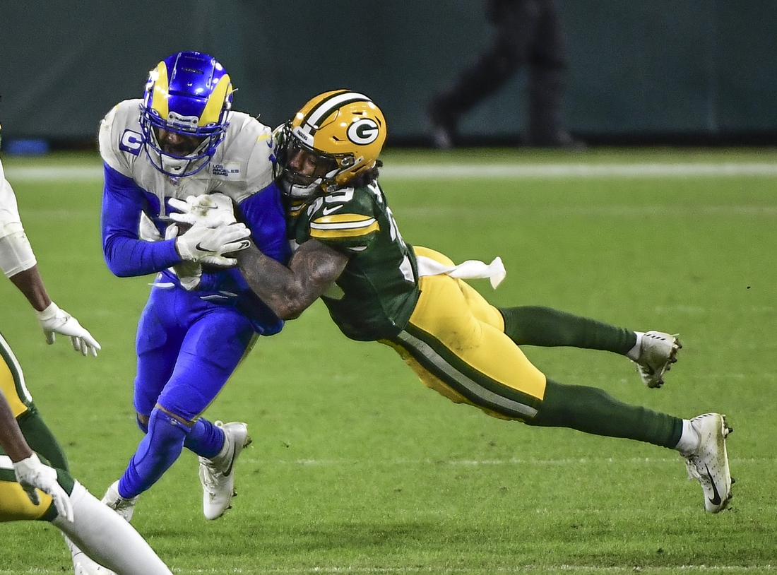 Jan 16, 2021; Green Bay, Wisconsin, USA; Los Angeles Rams wide receiver Robert Woods (17) is tackled by Green Bay Packers cornerback Chandon Sullivan (39) in the fourth quarter at Lambeau Field. Mandatory Credit: Benny Sieu-USA TODAY Sports
