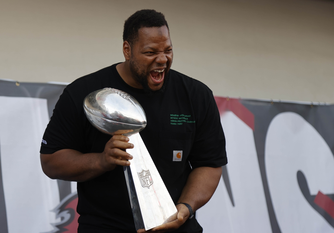 Feb 10, 2021; Tampa Bay, FL, USA;  Tampa Bay Buccaneers defensive end Ndamukong Suh holds the Vince Lombardi Trophy during a boat parade to celebrate victory in Super Bowl LV against the Kansas City Chiefs. Mandatory Credit: Kim Klement-USA TODAY Sports
