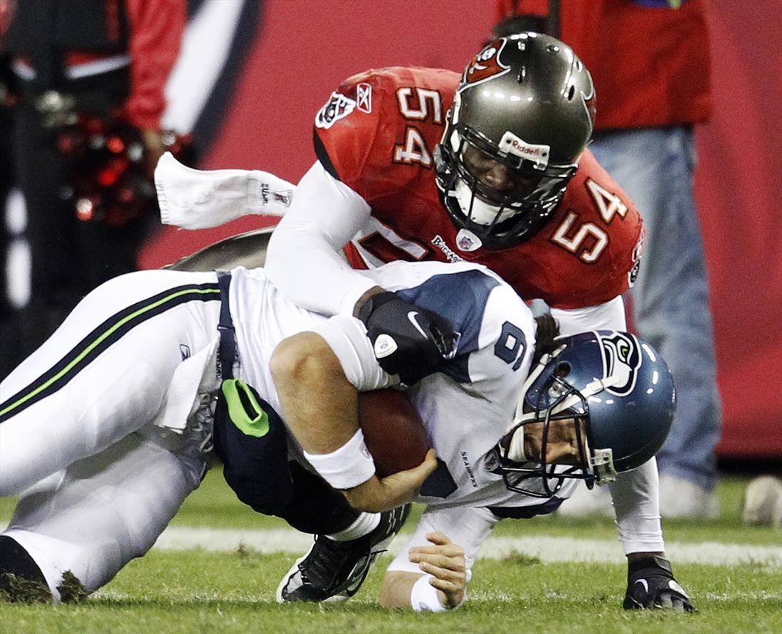 Tampa Bay Buccaneers linebacker Geno Hayes (54) sacks Seattle Seahawks quarterback Charlie Whitehurst (6) during their NFL football game in Tampa, Florida December 26, 2010. REUTERS/Pierre DuCharme