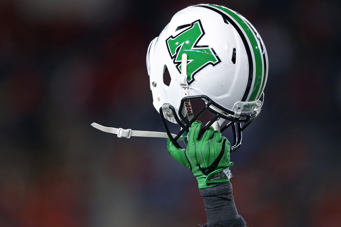 Sep 30, 2017; Cincinnati, OH, USA; A player of the Marshall Thundering Herd holds his helmet to celebrate the touchdown by tight end Ryan Yurachek (not pictured) against the Cincinnati Bearcats in the second half at Nippert Stadium. Mandatory Credit: Aaron Doster-USA TODAY Sports