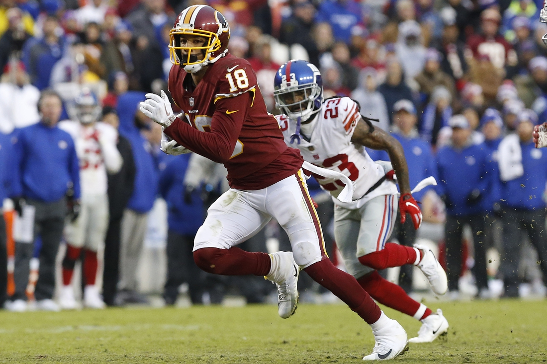 Dec 9, 2018; Landover, MD, USA; Washington Redskins wide receiver Josh Doctson (18) runs with the ball past New York Giants cornerback B.W. Webb (23) in the fourth quarter at FedEx Field. The Giants won 40-16. Mandatory Credit: Geoff Burke-USA TODAY Sports